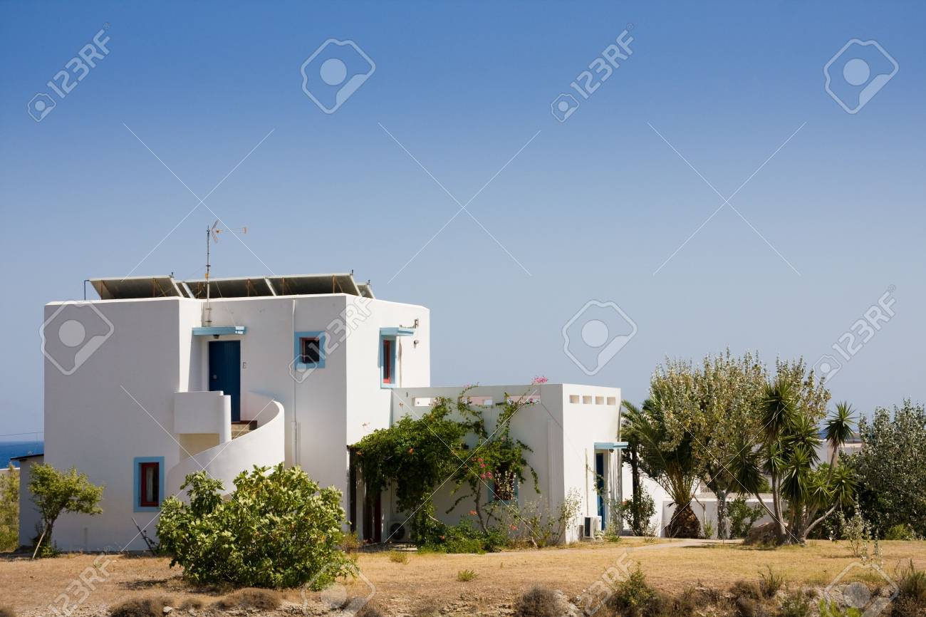Small white and blue house over blue sky Stock Photo - 5673632