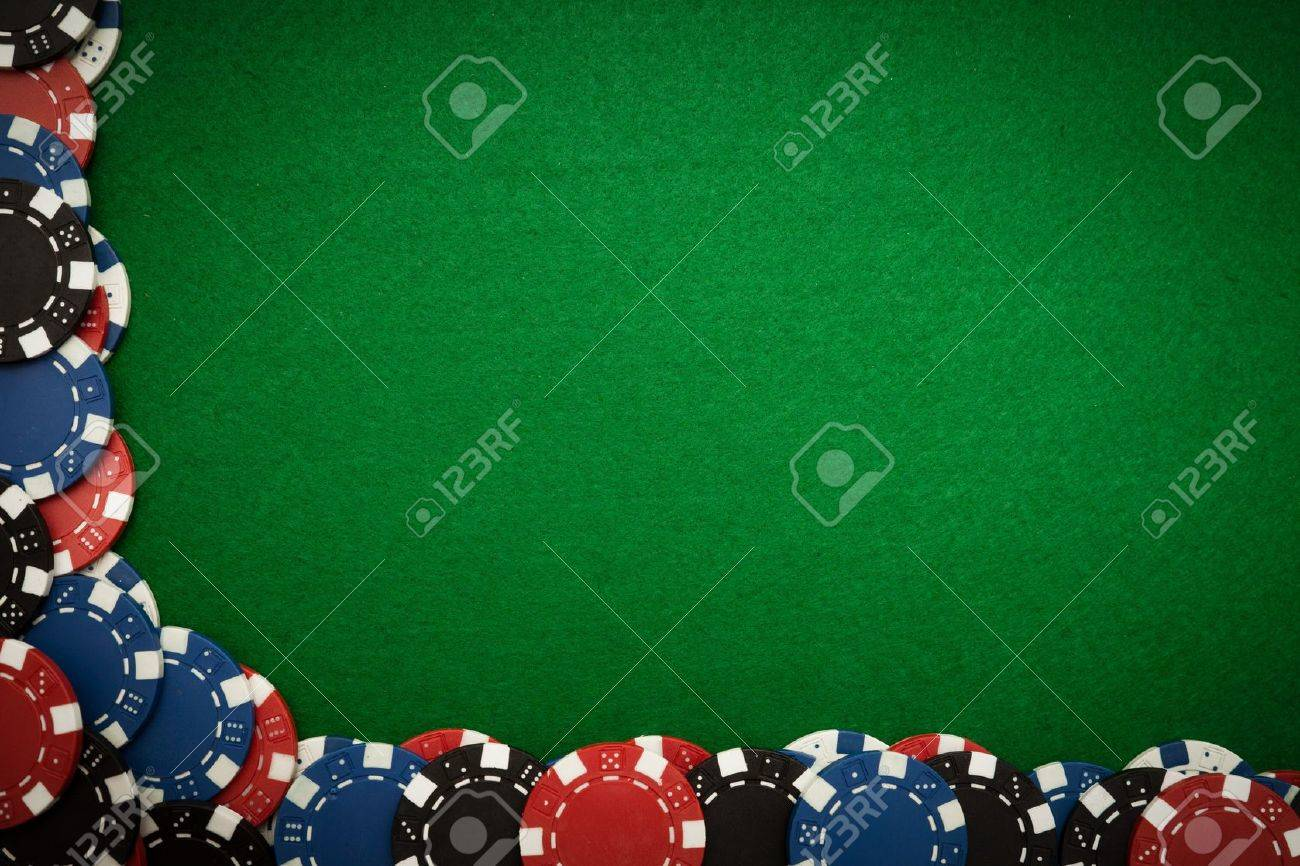 Poker table background - Poker table background colorful gambling chips on green felt background with copy space stock photo