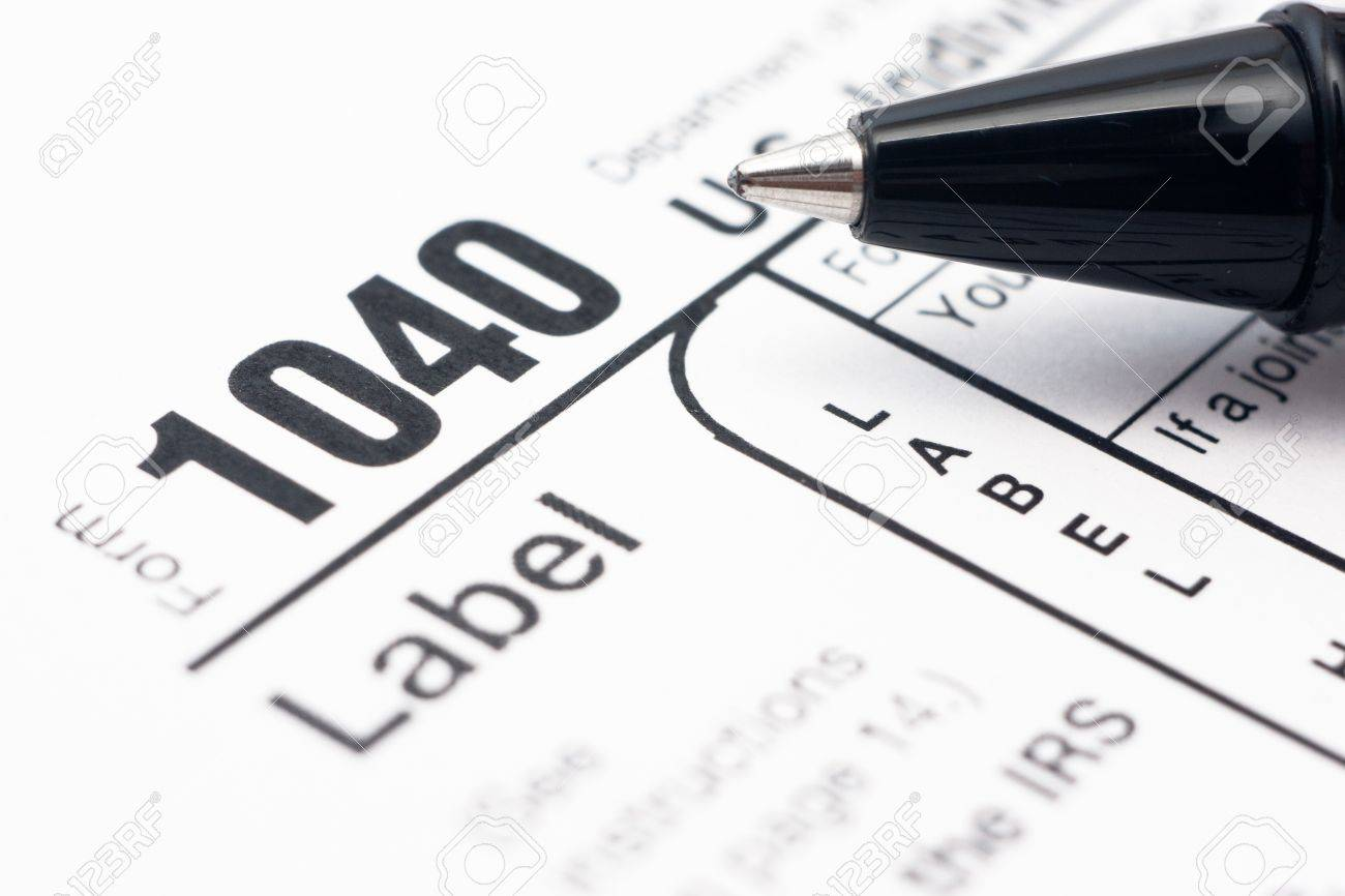 Filling In Tax Form 1040 By Ballpen Stock Photo, Picture And ...