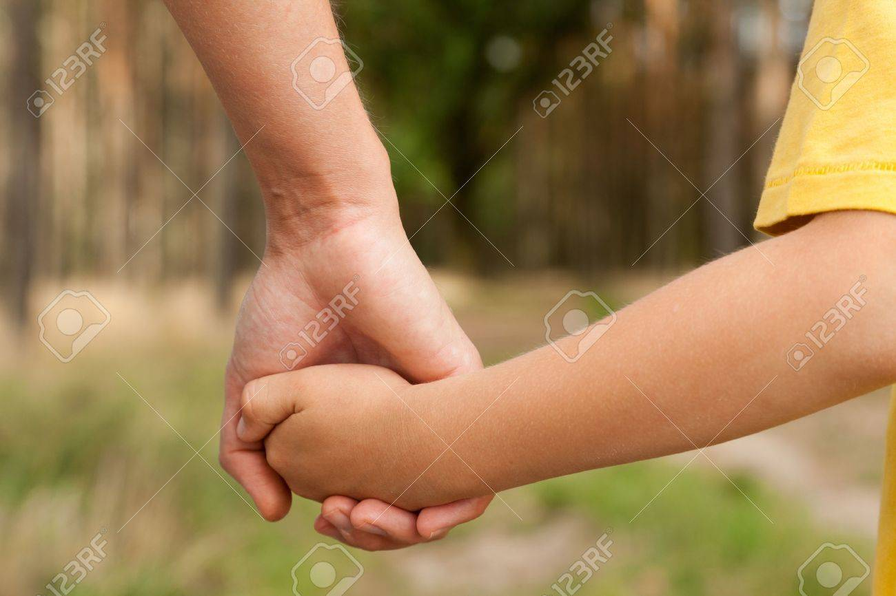Mother holding a hand of his son in summer day outdoors Stock Photo - 10885805