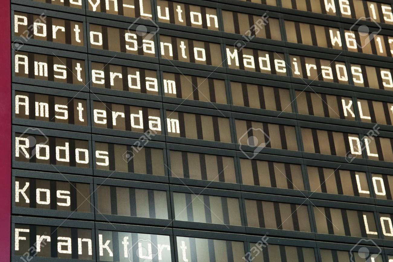 Flight arrival and departure board on an airport Stock Photo - 10885801