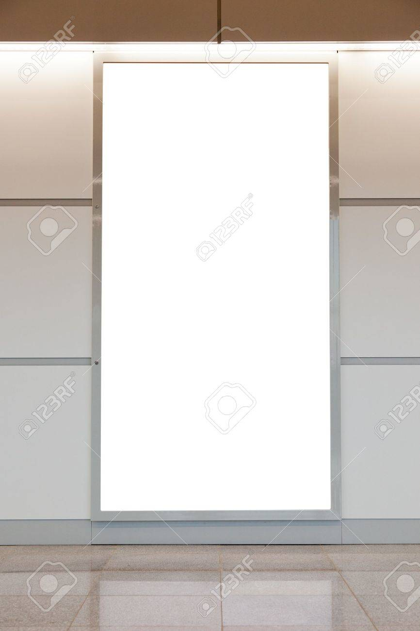 Vertical blank billboard on a bright wall Stock Photo - 11362522