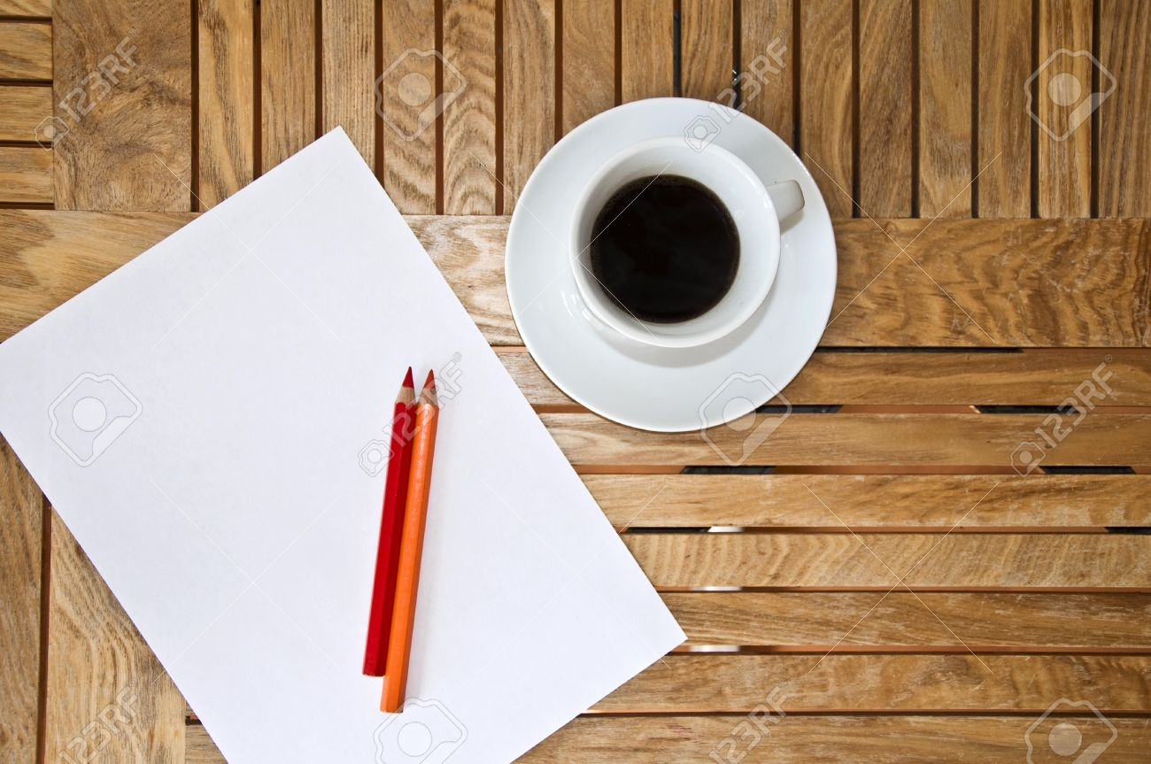 Paper blank sheet color pencil and a cup of coffee on a wooden paper blank sheet color pencil and a cup of coffee on a wooden table geotapseo Gallery