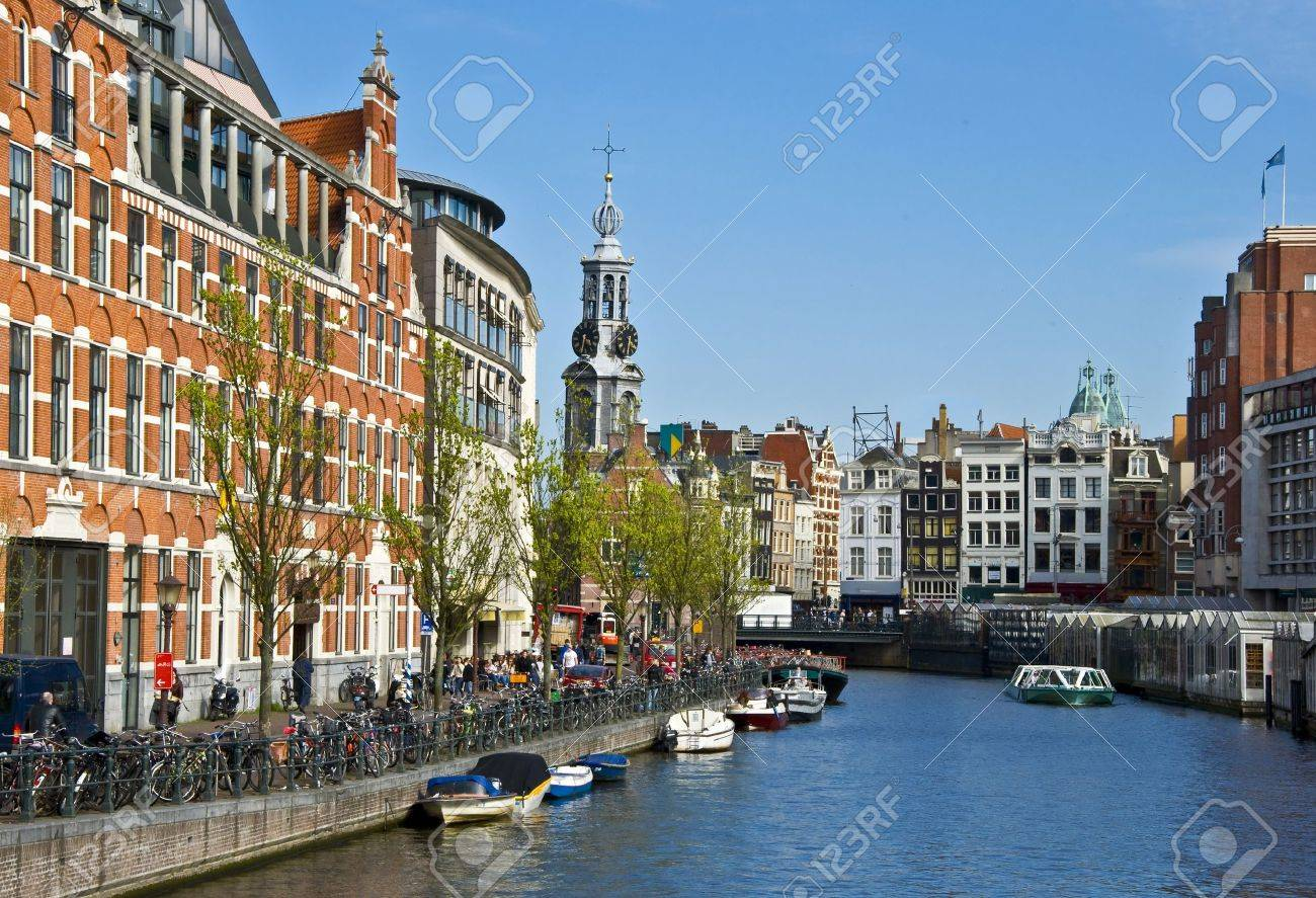 Channels in Amsterdam. Typical Amsterdam architecture. Floating Flower Market. Urban space in the spring. Stock Photo - 10071923