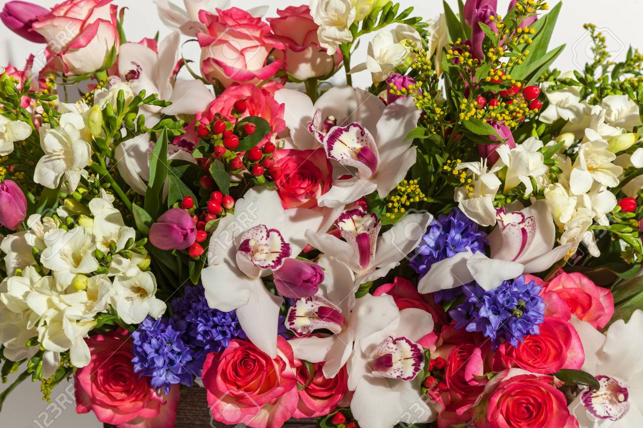 Bouquet in the box big bright bouquet of different flowers close bouquet in the box big bright bouquet of different flowers close up in the wooden izmirmasajfo
