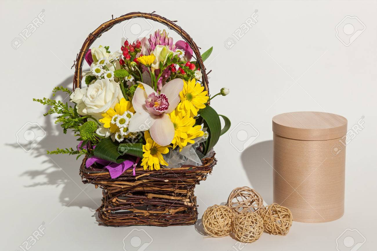 Different beautiful flowers in the basket round beige box and different beautiful flowers in the basket round beige box and handmade eggs close up on izmirmasajfo