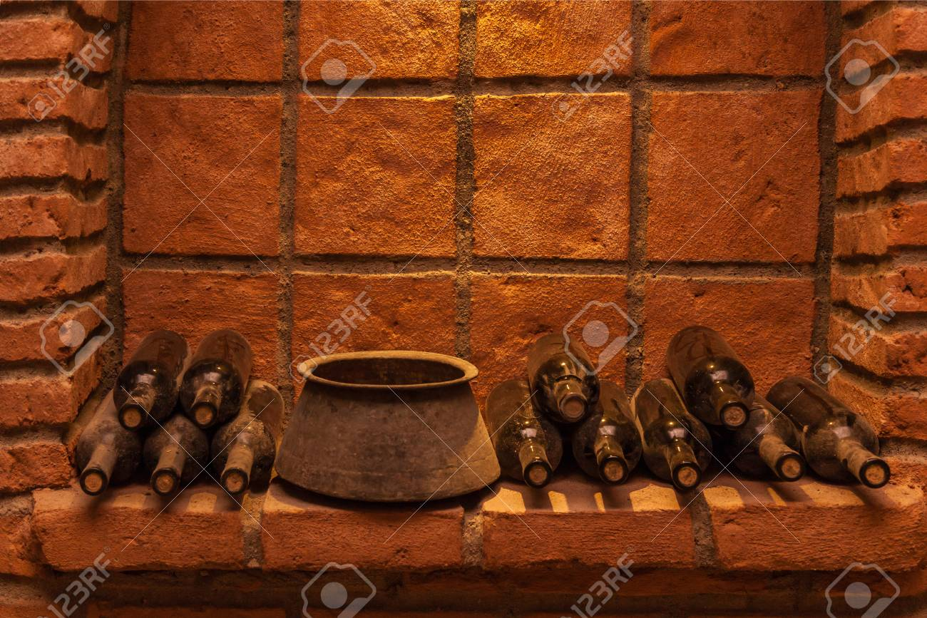 Winy Bottles Lie On Bricks In Basement Old Wine Cellars With Stock Photo Picture And Royalty Free Image Image 84132862