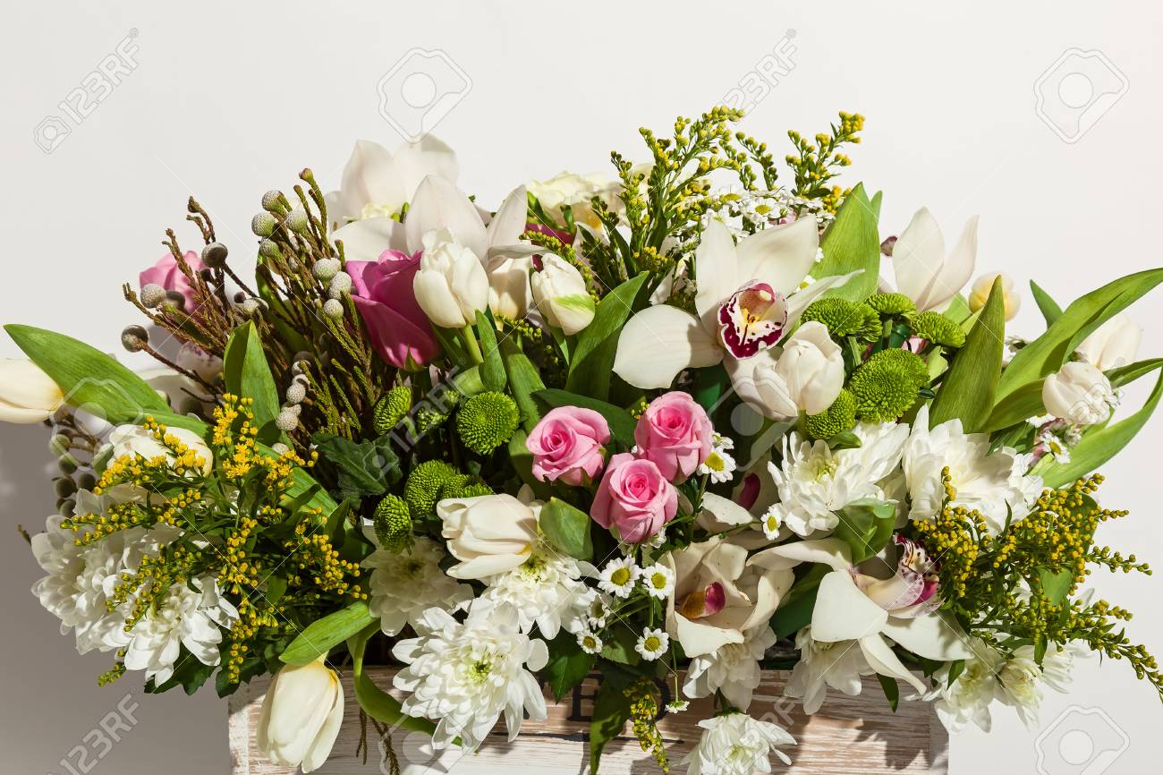 Composition Of Flowers From Pink Roses, White Orchids, Red Tulips ...