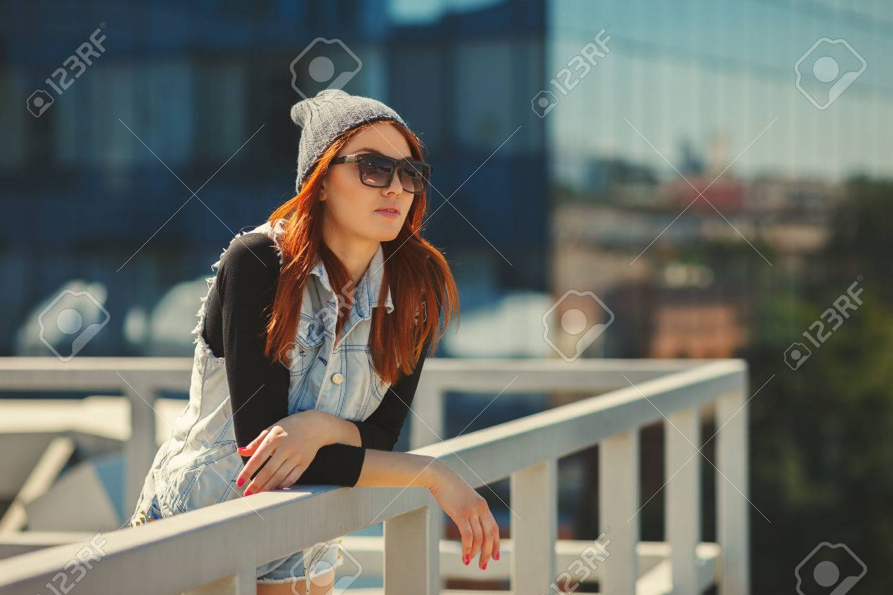Outdoor fashion lifestyle portrait of pretty young girl, wearing in hipster  swag grunge style urban