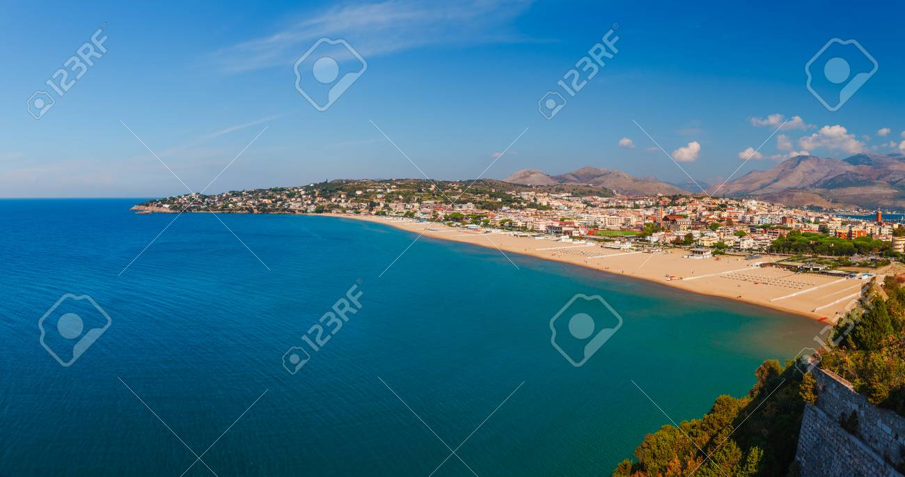 Panoramic sea landscape with Gaeta, Lazio, Italy. Scenic historical town with old buildings, ancient churches, nice sand beach and clear blue water. Famous tourist destination in Riviera de Ulisse - 122969077