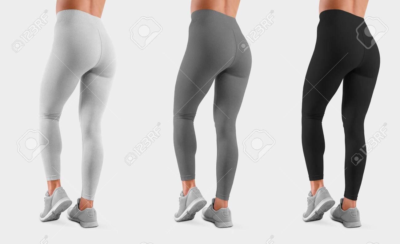 Template sweatpants on a fit girl with bent leg, isolated on background, back view. Mockup of white, gray, black leggings on a model for design presentation. Set of women's clothing - 149117288