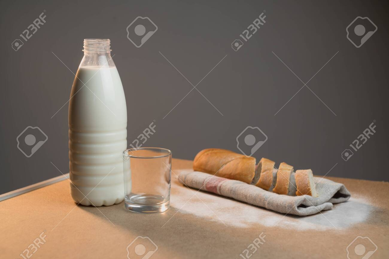 A full bottle of vegetable milk on the table next to the village bread. The concept of home comfort at breakfast. - 147546849
