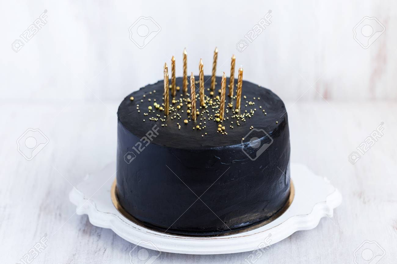 Superb Black Birthday Cake With Golden Candles On White Background Stock Personalised Birthday Cards Paralily Jamesorg