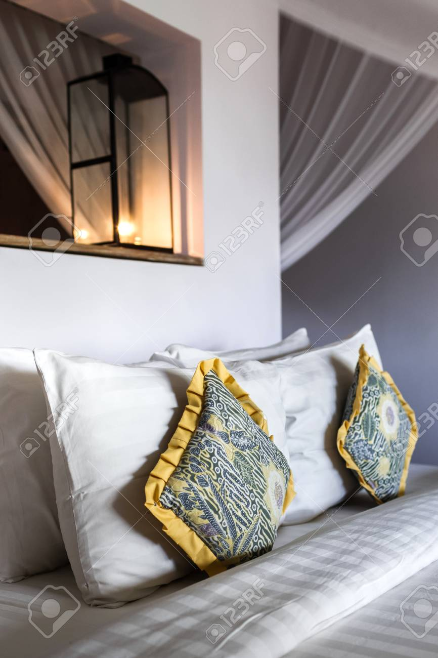 Yellow Handmade Pillows On White Cleaned Bed Stock Photo Picture And Royalty Free Image Image 63450376