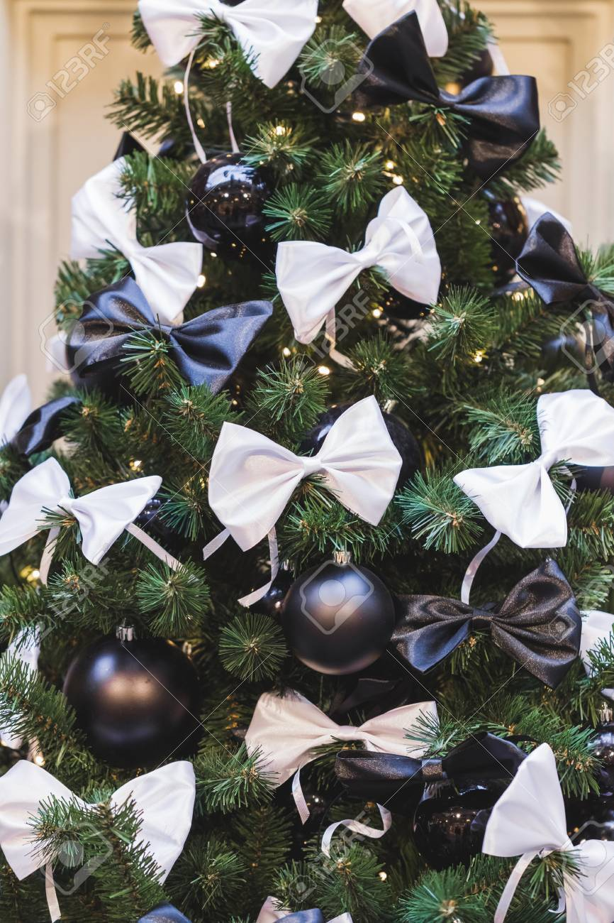 Christmas Tree Bows White.Christmas Tree Decorated In Black And White Style With Balls