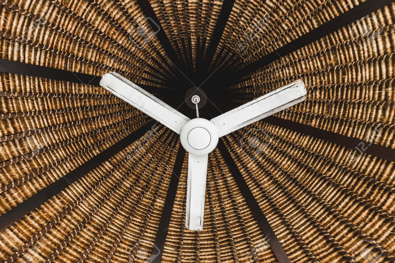 Old Ceiling Fan Hanging Under Wooden Wicker Roof Asian Style