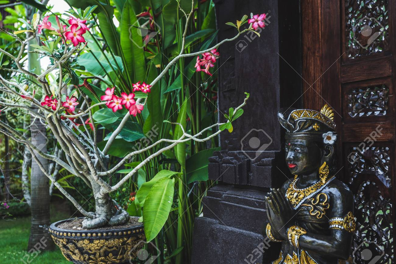 Black And Gold Statuette Of A Hindu Deity In Ubud Garden In Bali