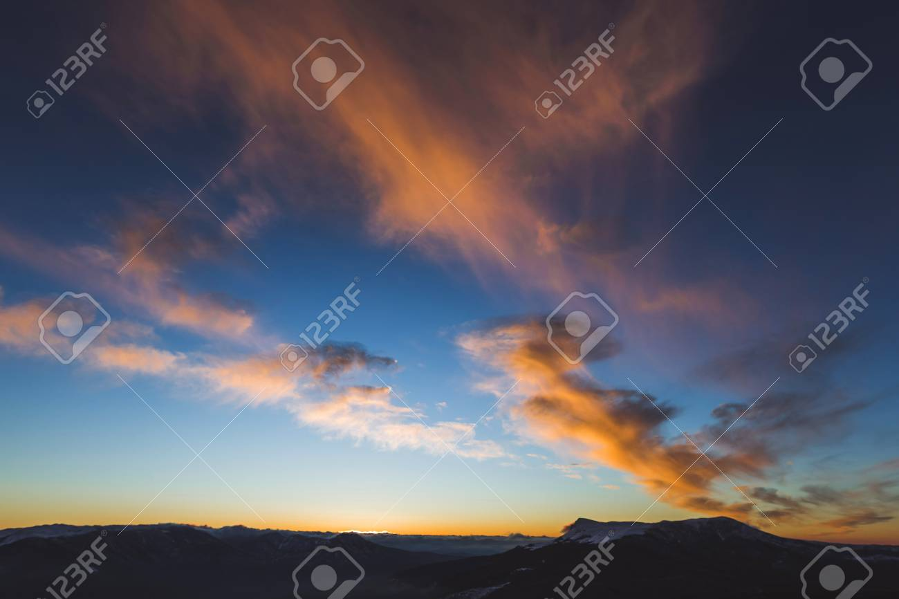 Amazing Colorful Sunset High In Mountains Orange Clouds And
