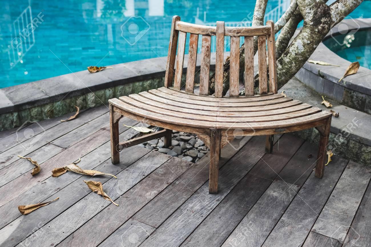 Super Wooden Bench Near Swimming Pool In Luxury Resort Wooden Floor Ibusinesslaw Wood Chair Design Ideas Ibusinesslaworg