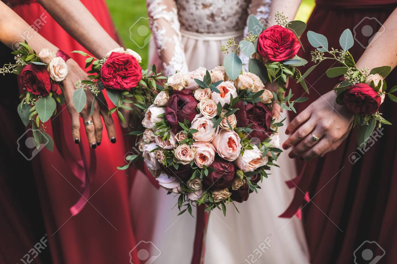 Flower Bracelets With Red Roses And Silk Ribbons Bridesmaids