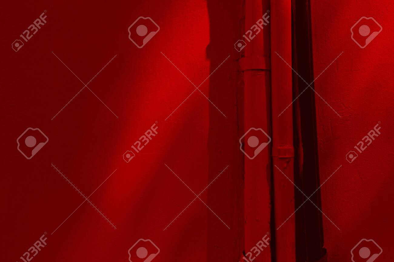 plastered wall red color with tubes. shadows on the wall. - 142018507