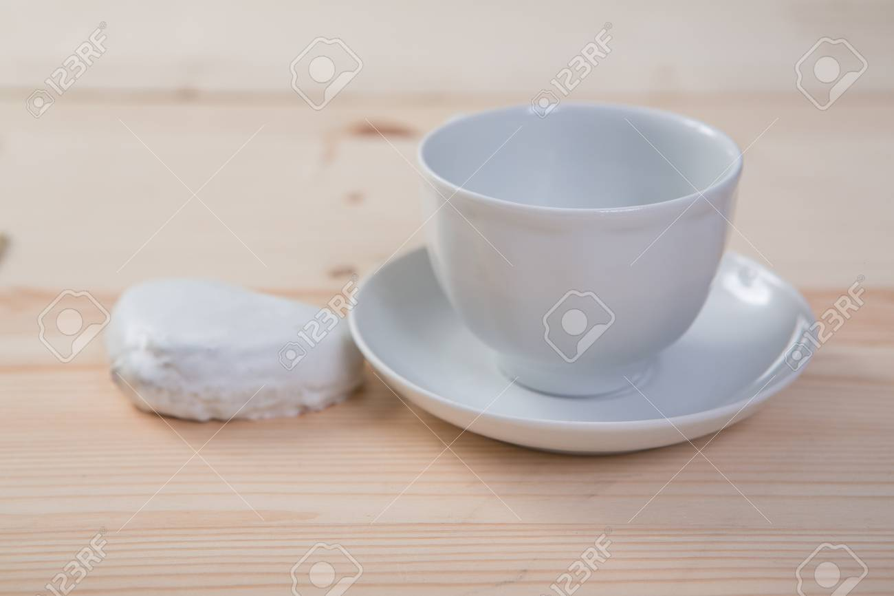 One Pure White Ceramic Cup And Saucer And Gingerbread Stands