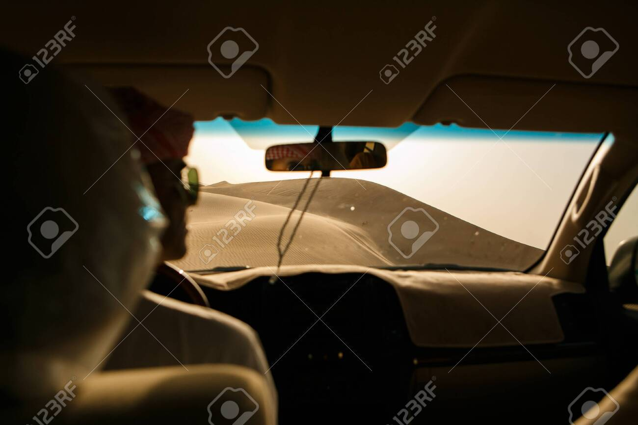Adventure, travel or active and extreme vacation concept: extreme safari. View of the sand dune from the off-road car. - 126264923