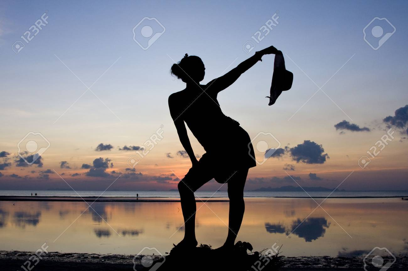 Woman silhouette in the sunset Stock Photo - 6508881