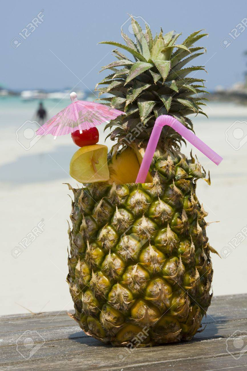 Tropical pineapple cocktail drink at the beach overlooking the ocean Stock Photo - 7105601