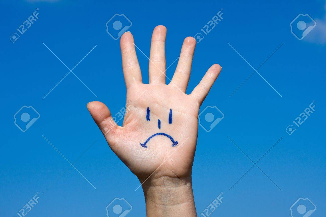 Human palm with sorrow pattern on blue sky background Stock Photo - 10954223