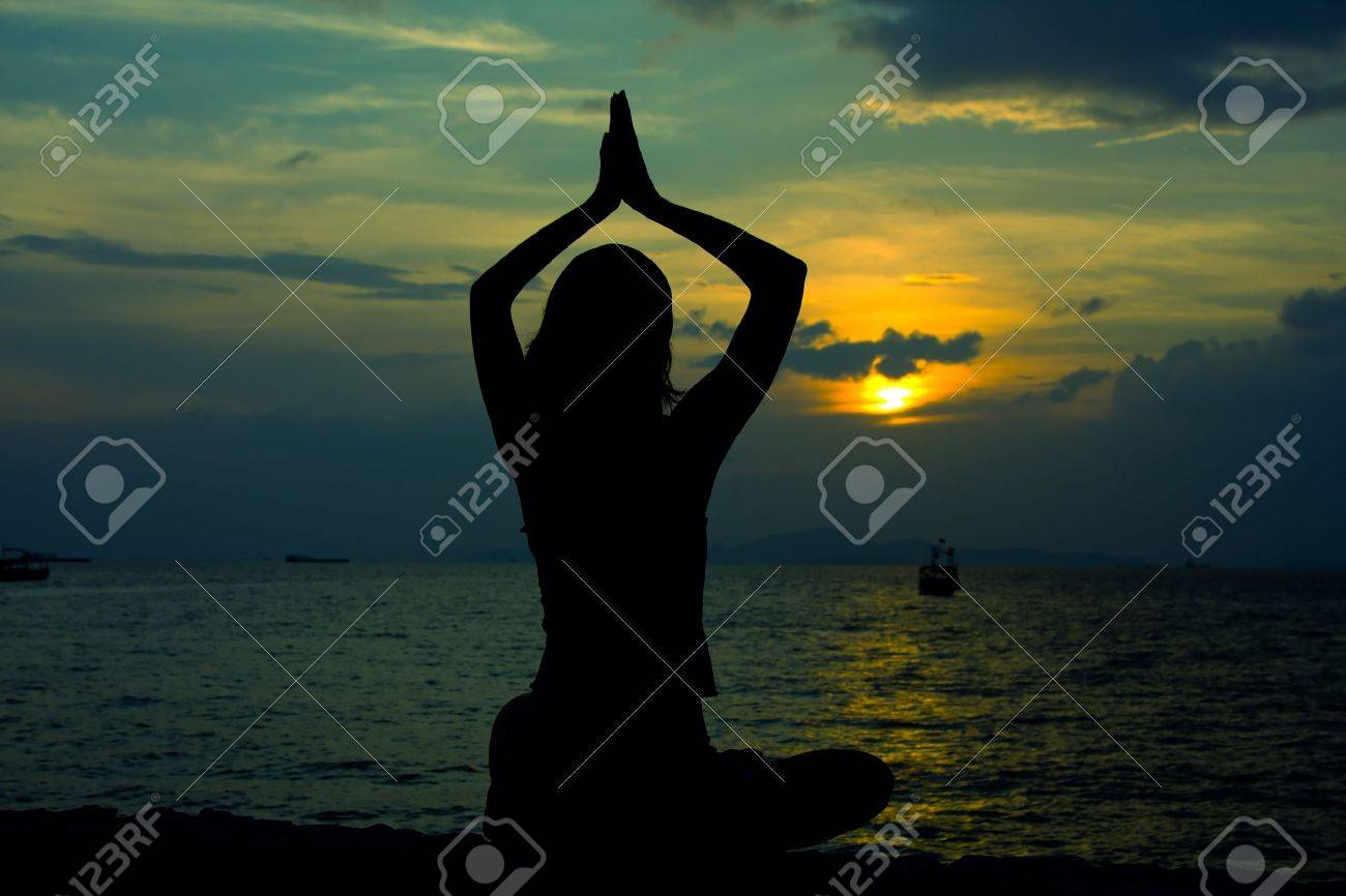 Healthy woman doing yoga outdoor, sunset over sea Stock Photo - 12843498