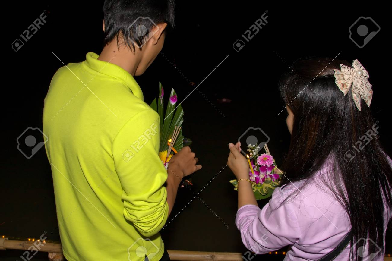 CHIANG MAI, THAILAND - NOVEMBER 10: Thai people float on water a small rafts (Krathong) to celebrate the Loy Krathong festival in Chiang Mai, Thailand on November 10, 2011 Stock Photo - 13537775