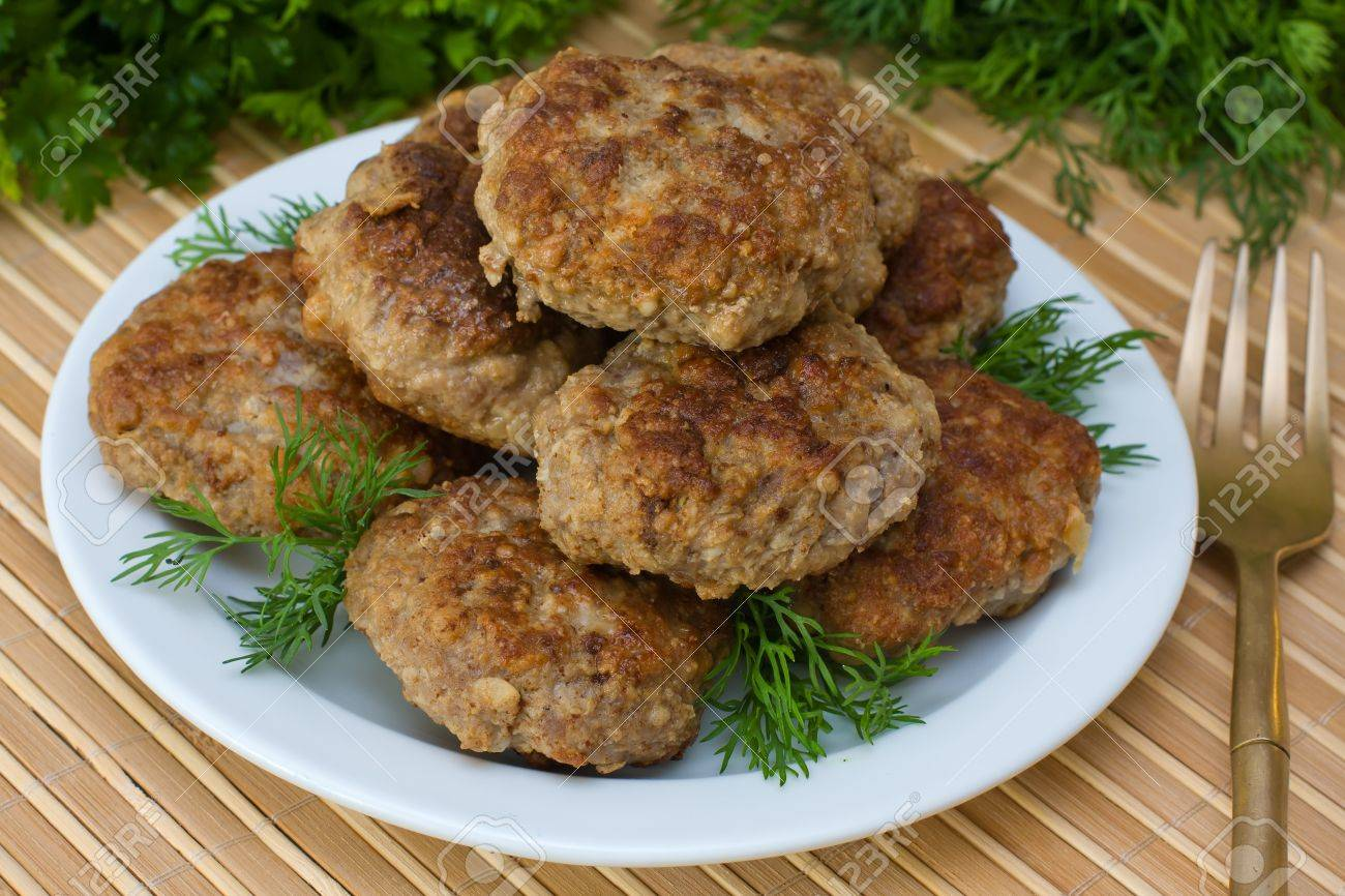 Fried cutlet with dill on a plate Stock Photo - 13705586