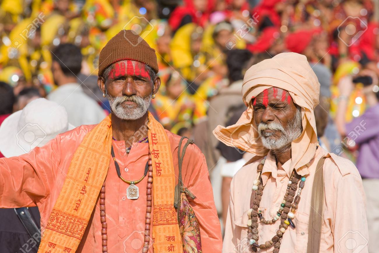 PUSHKAR, INDIA - NOVEMBER 21: Pushkar Camel Mela (Pushkar Camel Fair) on November 21, 2012 in Pushkar, Rajasthan, India. This fair is the largest camel trading fair in the world. An unidentified sadhu attends the Pushkar fair Stock Photo - 16377833