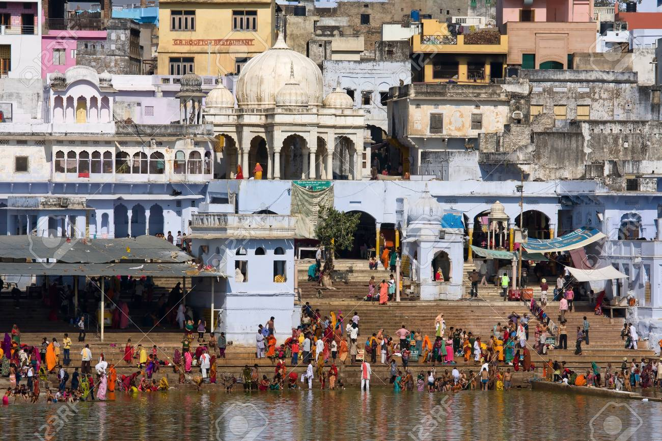 PUSHKAR, INDIA - NOVEMBER 18: people at ritual washing in the holy lake on November 18,2012 in Pushkar, India. A ritual bath in the lake is considered to lead one to salvation. Stock Photo - 19389080