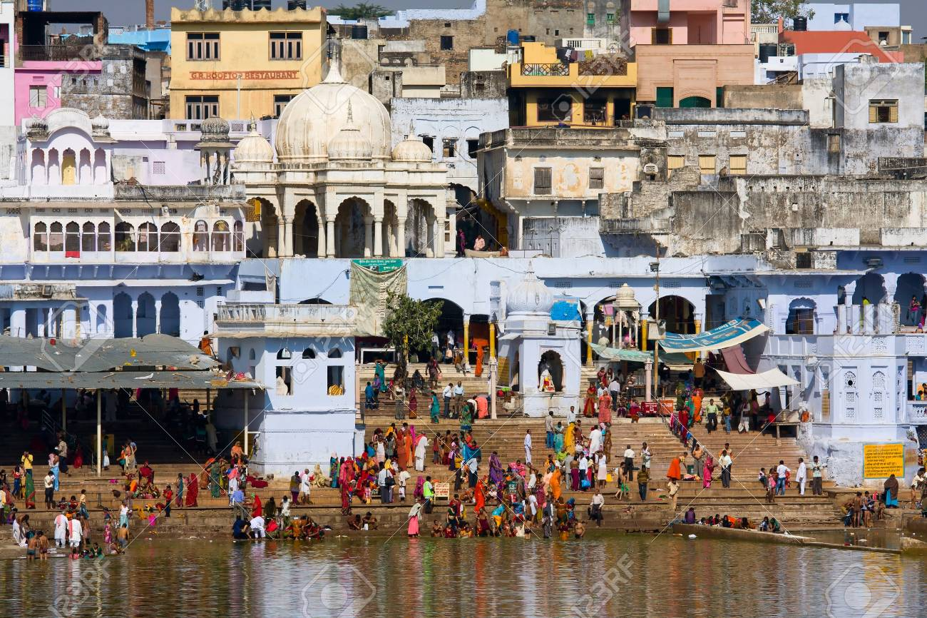 PUSHKAR, INDIA - NOVEMBER 18: people at ritual washing in the holy lake on November 18,2012 in Pushkar, India. A ritual bath in the lake is considered to lead one to salvation. Stock Photo - 20844224