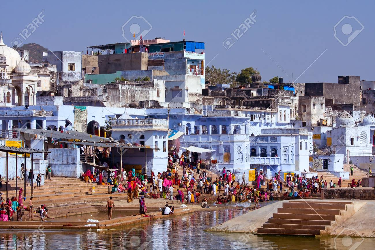 PUSHKAR, INDIA - NOVEMBER 18: people at ritual washing in the holy lake on November 18,2012 in Pushkar, India. A ritual bath in the lake is considered to lead one to salvation. Stock Photo - 21100100