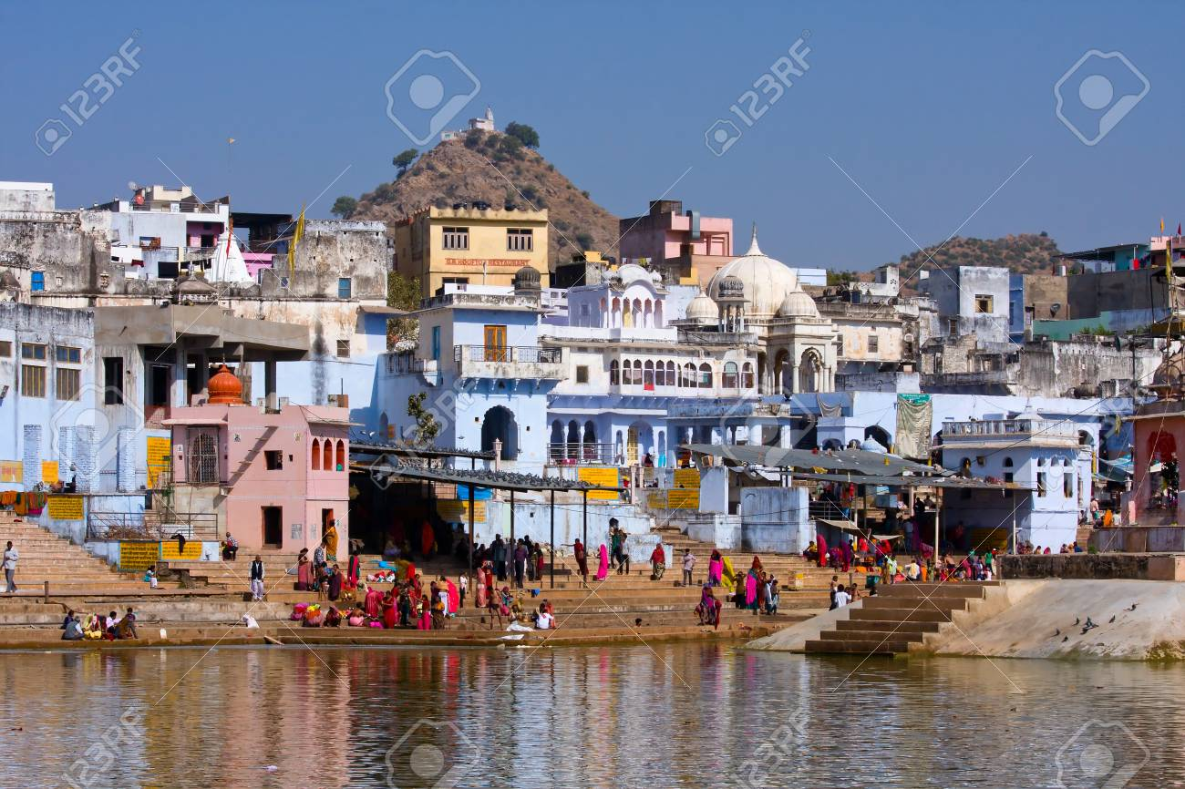 PUSHKAR, INDIA - NOVEMBER 18: people at ritual washing in the holy lake on November 18,2012 in Pushkar, India. A ritual bath in the lake is considered to lead one to salvation. Stock Photo - 22383455