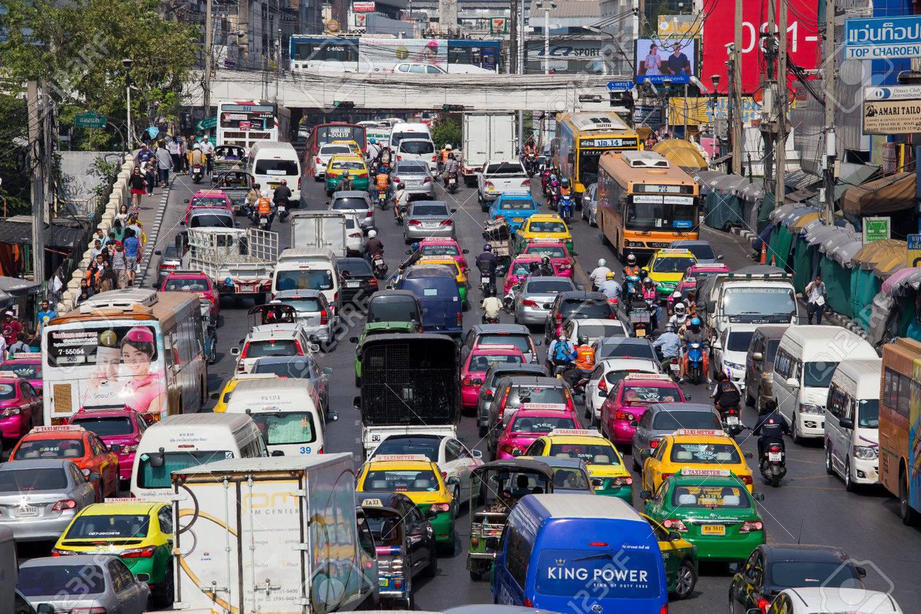 BANGKOK, THAILAND - JANUARY 22, 2015: Traffic moves slowly along a busy road in Bangkok, Thailand. Annually an estimated 150,000 new cars join the already heavily congested streets of Bangkok. - 49299663