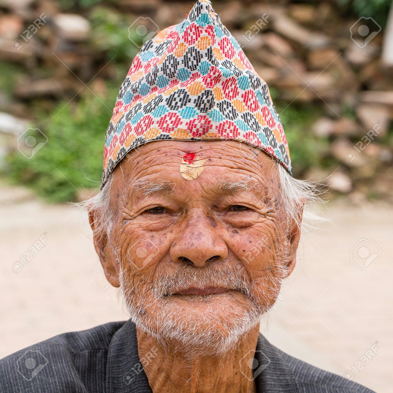 KATHMANDU, NEPAL - SEPTEMBER 29, 2016 : Portrait old men in traditional