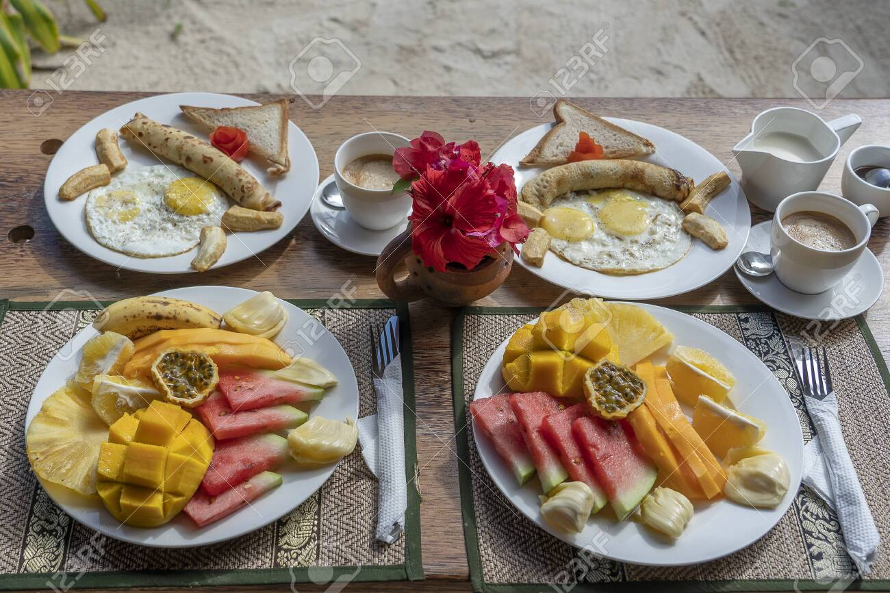 Tropical Breakfast Of Fruit Coffee And Scrambled Eggs And Banana Stock Photo Picture And Royalty Free Image Image 138043467