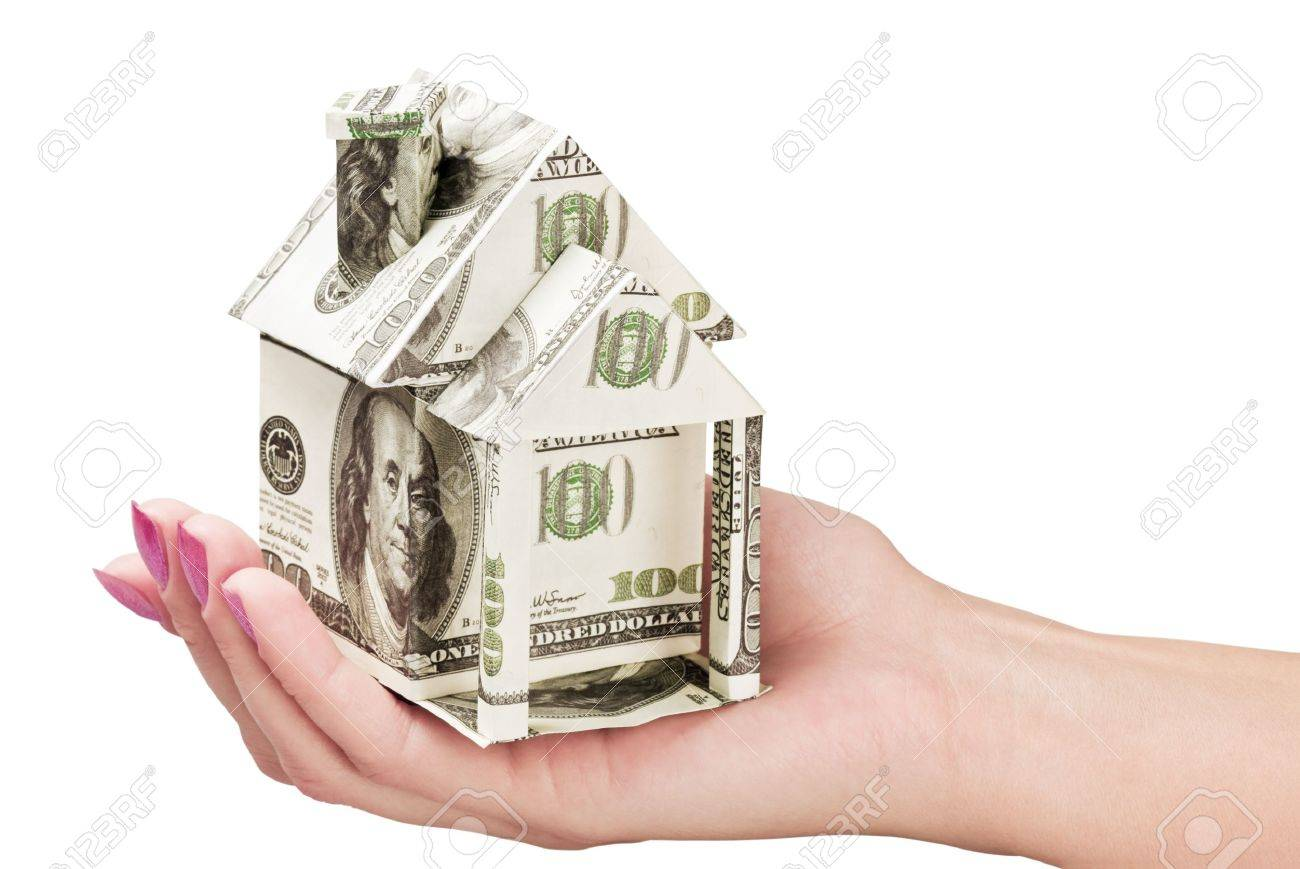 hand holds a house made from dollars Stock Photo - 11173633