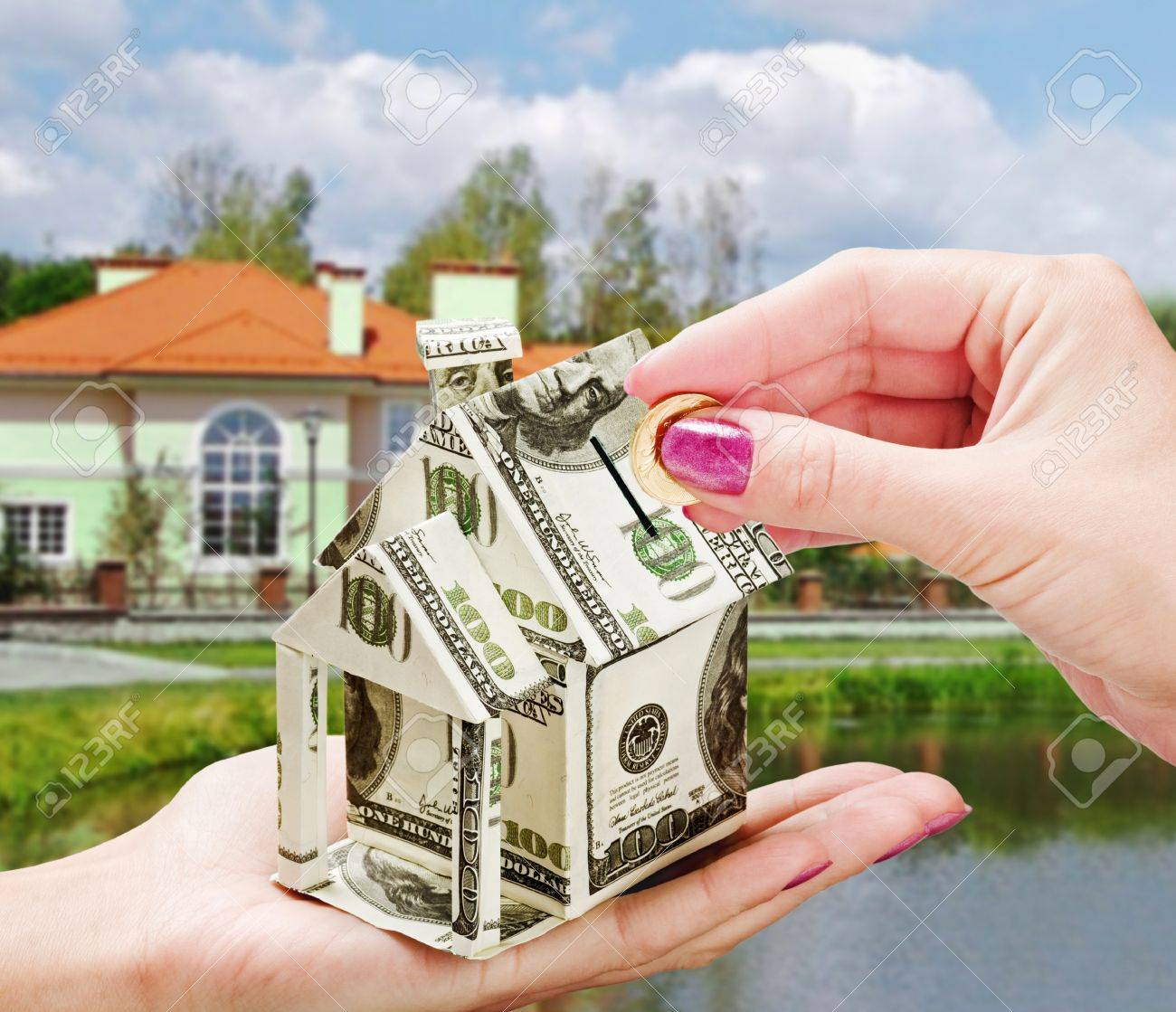 we collect money in the piggy bank on the purchase of a new home Stock Photo - 11737800