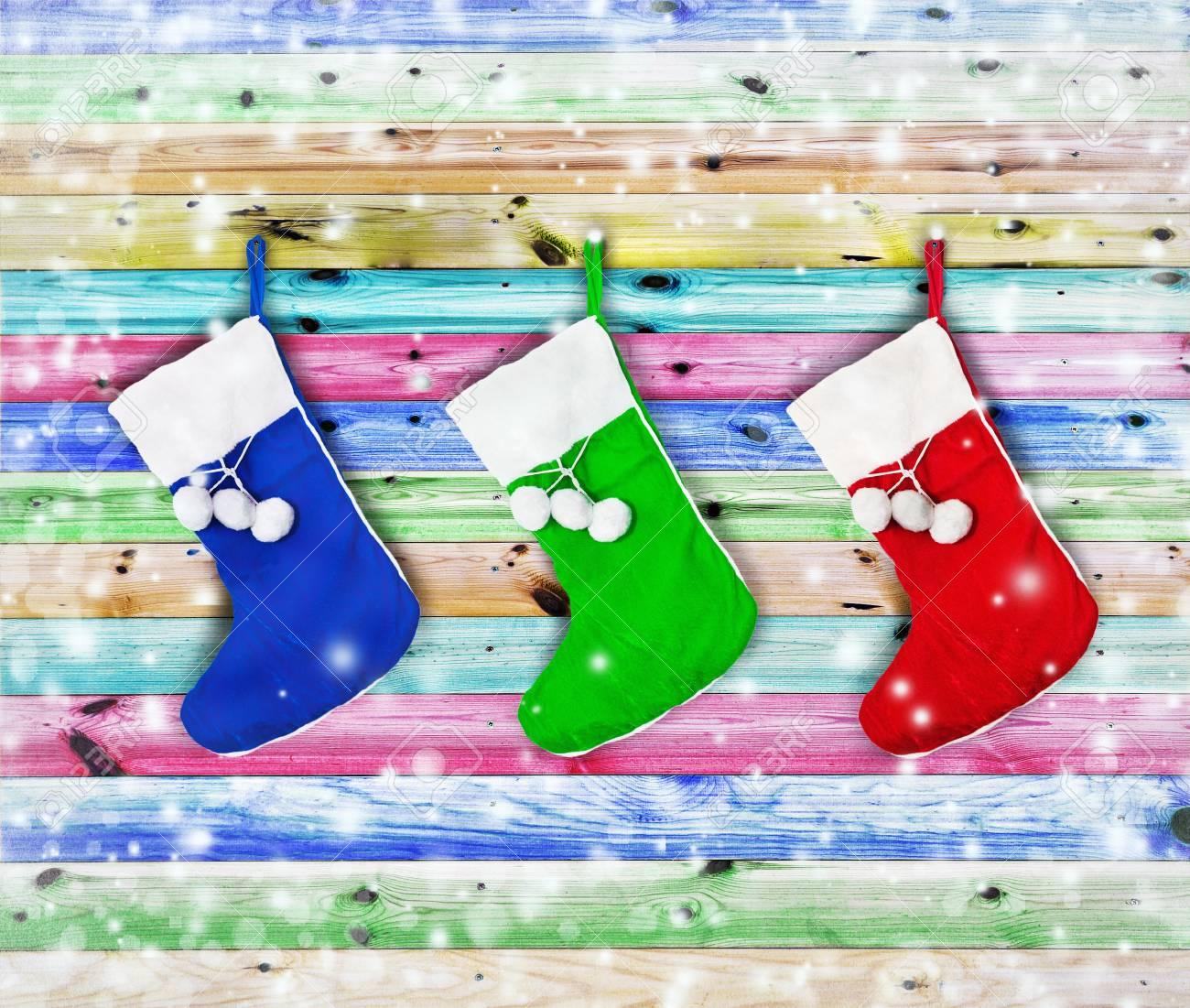 Christmas socks hung on a wooden fence color Stock Photo - 16353468