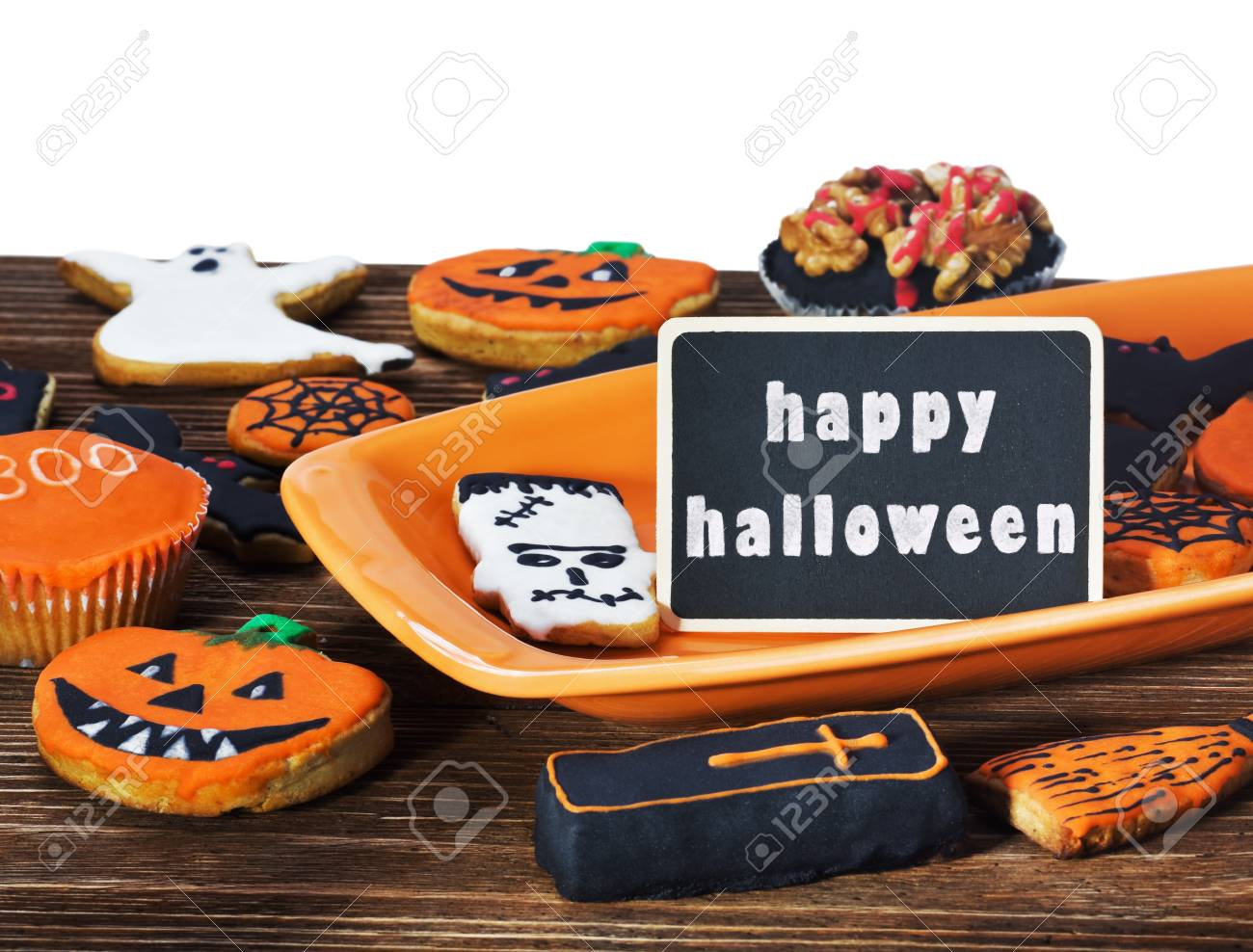 halloween cookies on a plate orange and black label and holiday greetings stock photo 21986602