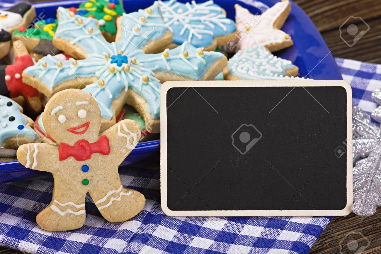 Sweets and biscuits for christmas and a blackboard with a greeting sweets and biscuits for christmas and a blackboard with a greeting for the holiday stock photo kristyandbryce Images
