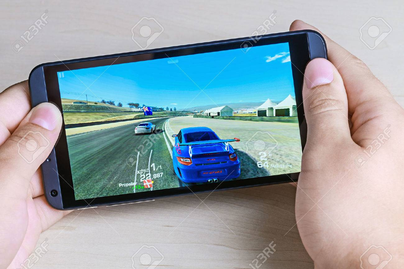 Moscow, Russia - August 26, 2014: Real Racing 3 game for android on your smartphone htc. Real Racing 3 game for mobile devices in the genre of road racing simulator. - 31187673
