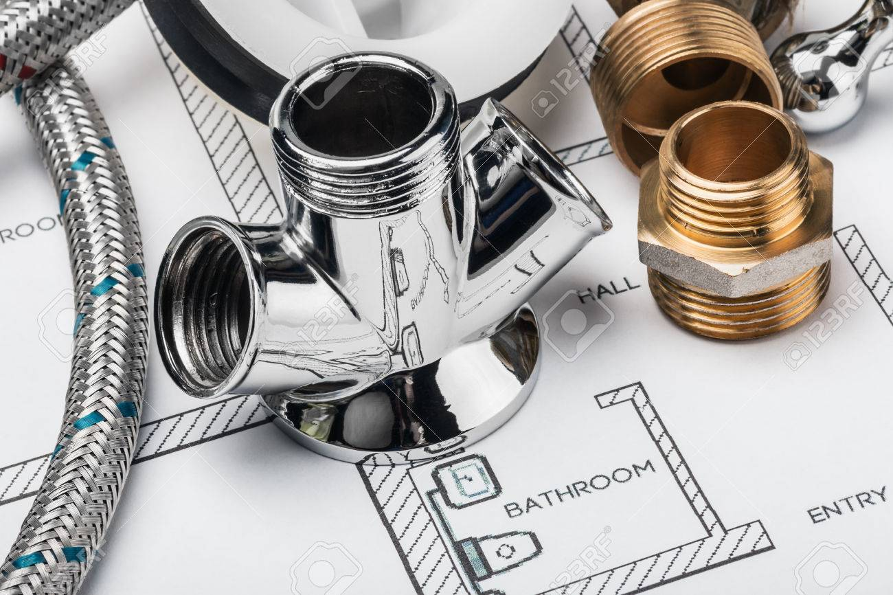 plumbing and tools lying on drawing for repair - 32257744