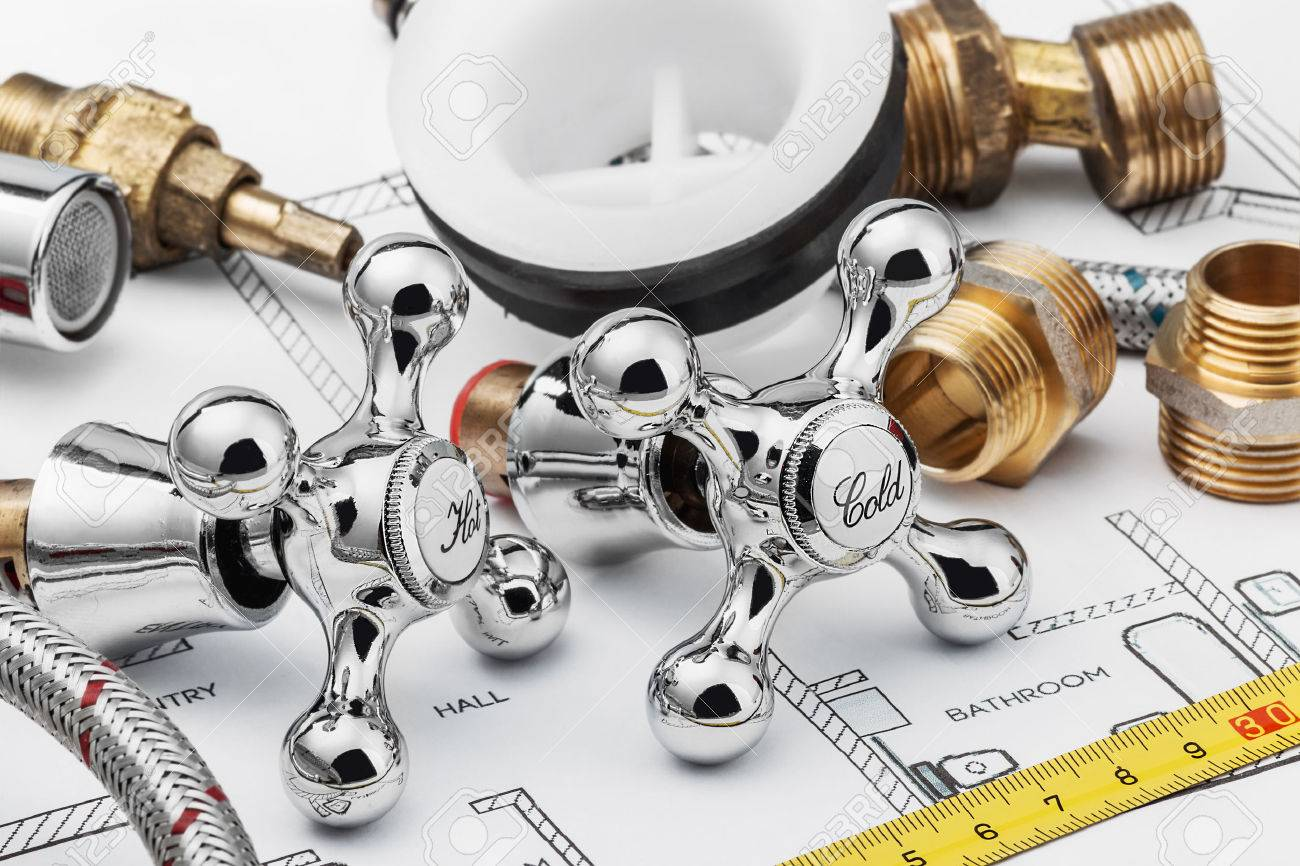 plumbing and tools lying on drawing for repair - 33215129