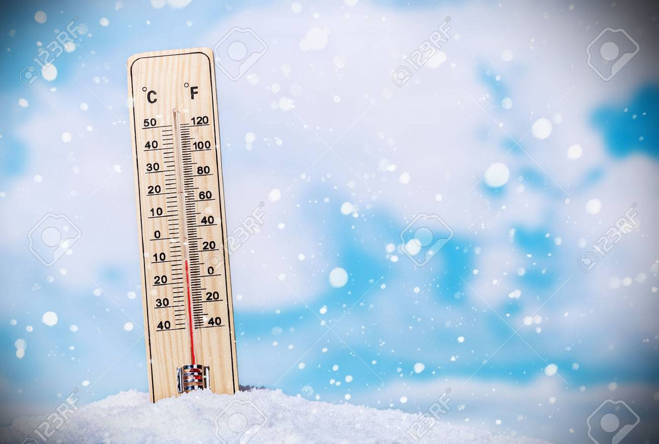 Thermometer on snow shows low temperatures on the sky with clouds - 33726749